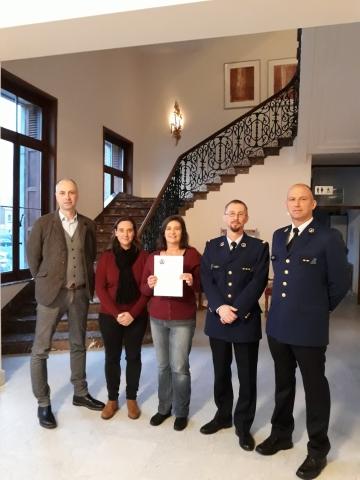 Foto van politieinspecteurs en de BIN-coördinatoren